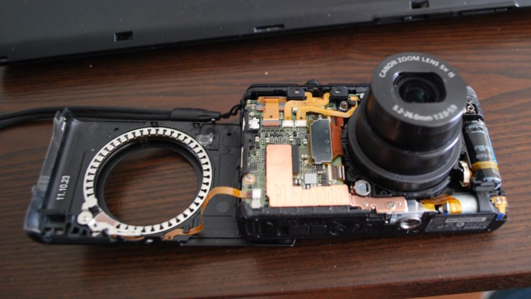 A Canon S100 digital camera with its outer casing removed